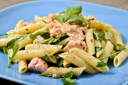 Italian Cuisine  pasta first dish with salmon and arugula
