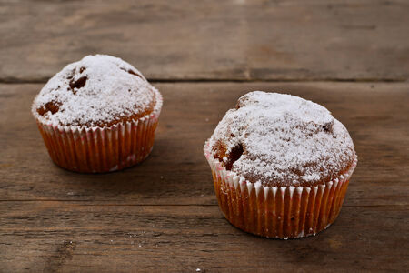 Closeup of an apple muffin on a rustic wooden board. Stock Photo
