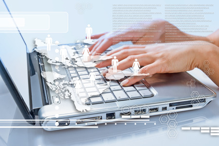 communication concept. Business woman typing on the keyboard of his laptop Stock Photo