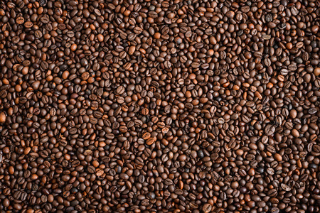 wooden spoon: Mixture of different kinds of coffee beans. Coffee Background