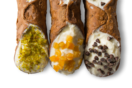 Traditional homemade Sicilian sweet called cannoli stuffed with cream cheese Stock Photo