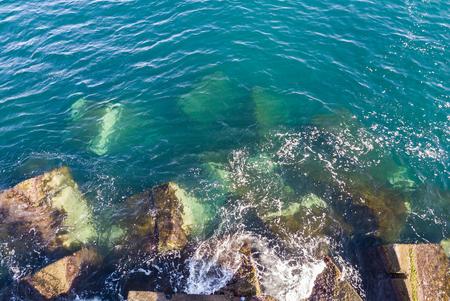 aerial view waves on a breakwater 版權商用圖片