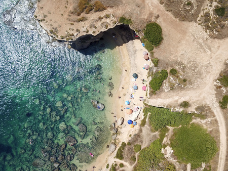Aerial View of a beautyful Sandy Beach and Sea with turquoise water