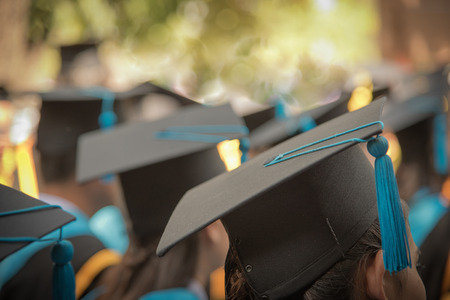 Selective Focus On Graduation Cap Of Front Female In Graduation Ceremony Row 스톡 콘텐츠