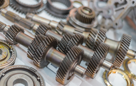 shiny floor: Selective Focus Shiny Gears And Shafts On White Floor Stock Photo