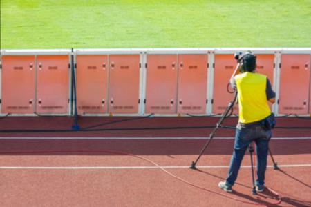 Defocused Of Cameraman Shooting Live Broadcast Soccer Match