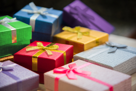 boxes stack: Various color of christmas&happy new year gift boxes stack, reward holiday presents greeting celebration card concept background, selective focus.
