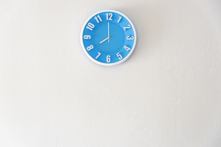 Good morning or night time with 8:00 clock on white concrete wall interior background with copy space, message board concept. Good morning is the greeting in the morning, 8am is the working time