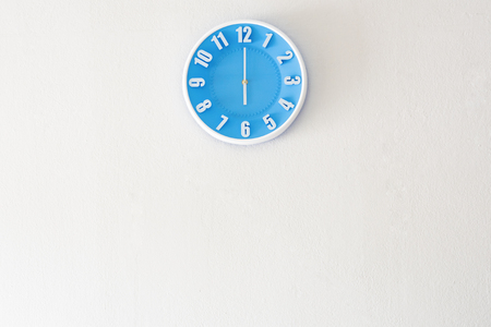 Good morning or evening time with 6:00 clock on white concrete wall interior background with copy space, message board concept. Good morning or evening is the greeting in the morning and evening