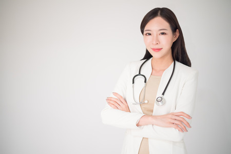 Beautiful asian woman female doctor isolated on white background, medical, doctor, clinical, hospital concept. Woman or female doctor is lacked in some country. Doctor is the necessary career. Stock Photo - 95542827