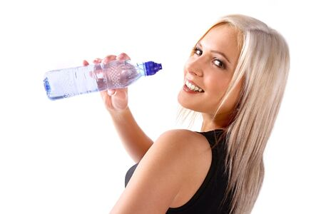 Woman in fitness attire holding water bottle and smiling photo