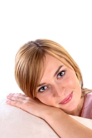 Young woman lays on a white pillow Stock Photo - 6225292