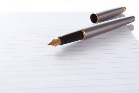 Fountain pen lying on page  photo