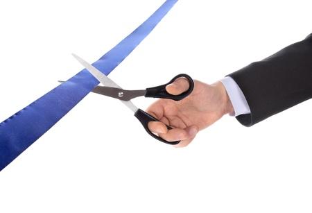 scissors cutting: A man cutting a ribbon