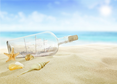 Ship in a bottle on the beach photo