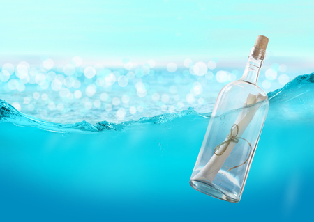 message in bottle: Bottle with a message in the water. Stock Photo