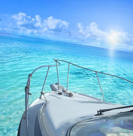palm: Yacht on tropical sea.