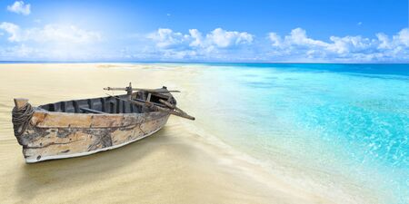 Old fishing boat on the seashore. Sandy beach. Zdjęcie Seryjne