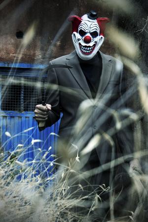 Creepy and scary clown having fun