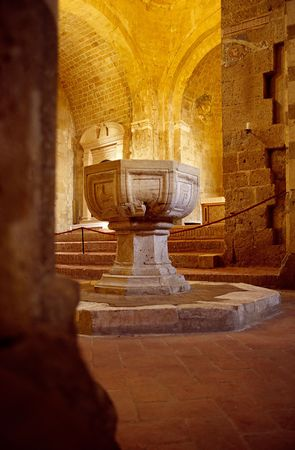 a beautiful baptistery in an antique church in tuscany Standard-Bild