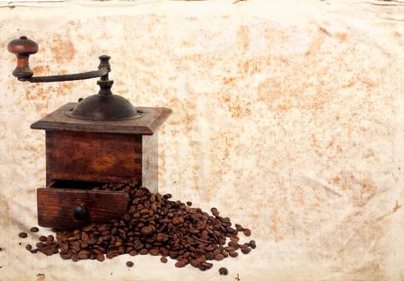 untitled key: vintage coffee mll with  bean on old paper Stock Photo