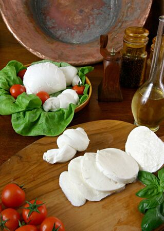 a fresh italian cheese with tomatoes and basil Stock Photo