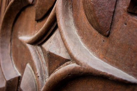 saluzzo: detail of an ancient wood door in Saluzzo, a beautiful town in Italy