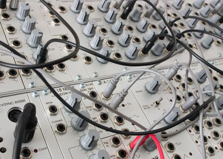 closeup of an analog modulare synthesyzer in a recording studio