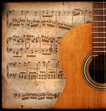 ancient music sheet, rusted old yellow paper with guitar photo