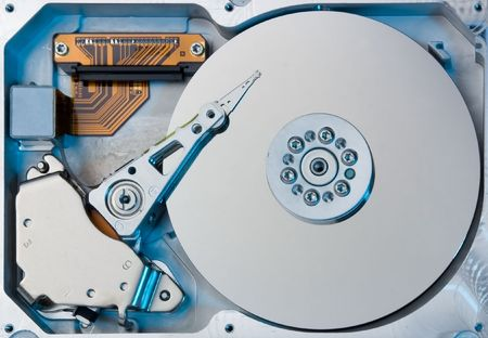 closeup of an hard drive with coloured light photo