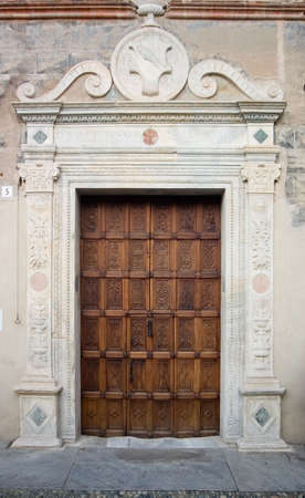 ancient wood door in Saluzzo, a beautiful town in Italy photo