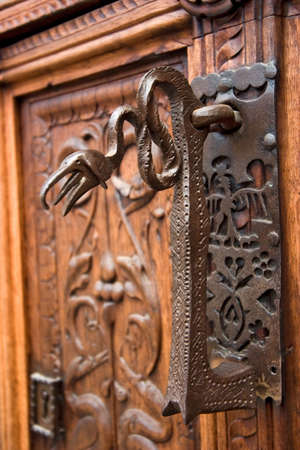saluzzo: ancient wood door in Saluzzo, a beautiful town in Italy