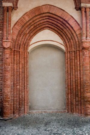 saluzzo: ancient walled door in Saluzzo, a beautiful town in Italy Stock Photo