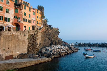 little harbor with boat at sunset in Riomaggiore - Cinque Terre - Italy photo