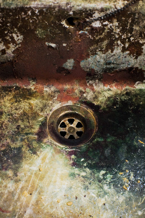 old disgusting dirty colourful drain in ancient industry photo