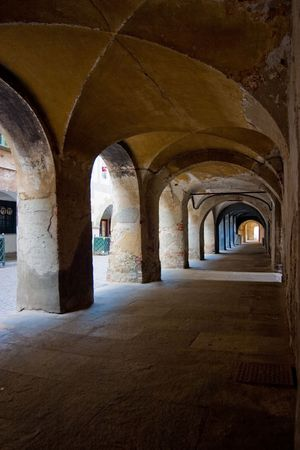 observes: ancient arch in saluzzo - north of italy