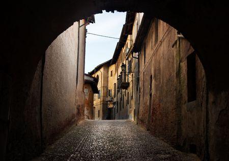 saluzzo: ancient arch in saluzzo - north of italy