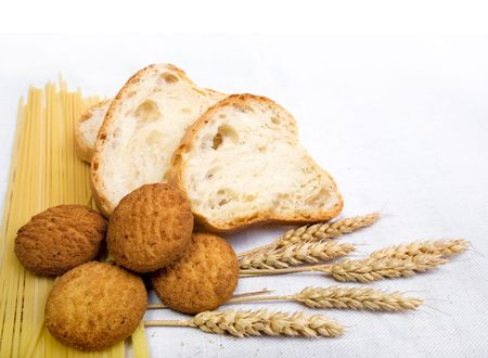 bread composition with grain on white fabric background