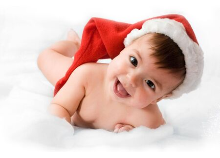 adorable baby smiling with christmas hat on white background photo