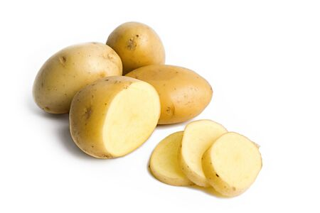 some yellow potatoes isolated on white  photo