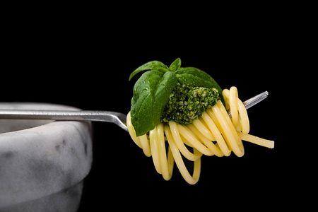 Spaghetti al pesto (a tipical italian sauce with basil, parmesan) Stock Photo