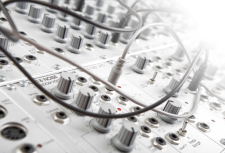 recording: closeup of an analog modulare synthesyzer in a recording studio