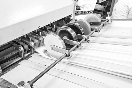 Folding machine working in printing industry photo
