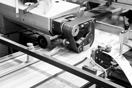 Close up printing machine during production