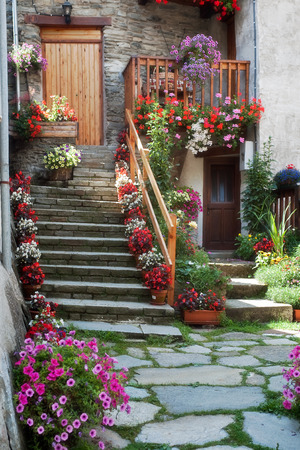 Staircase full of plants and flowers for a beautiful italian mountain house