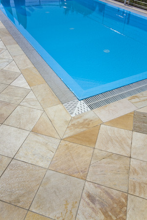 close up of a beautiful swimming pool with stones