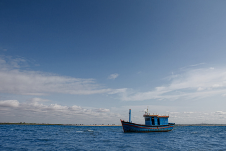 Blue fishing boat in the sea