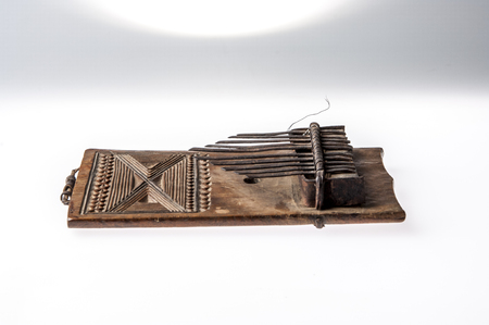 shamanism: African handmade music instrument isolated on white background