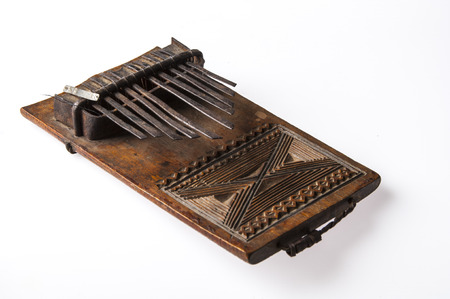 African handmade music instrument isolated on white background