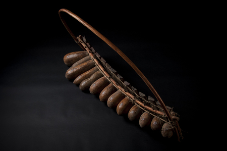 African music instrument, wooden marimba with two bakets, isolated on dark background Stock Photo